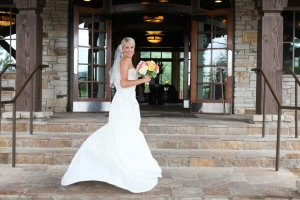 Author Summer Land in her wedding dress holding a bouquet