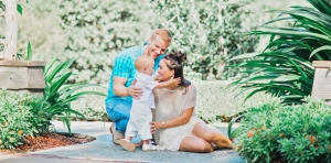 Catherine Giudici Lowe with her husband and baby outdoors