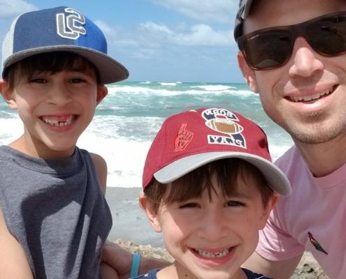Joel Cruz-Davis and his two sons at the beach
