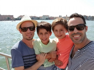 Joel Cruz-Davis with his husband and two sons