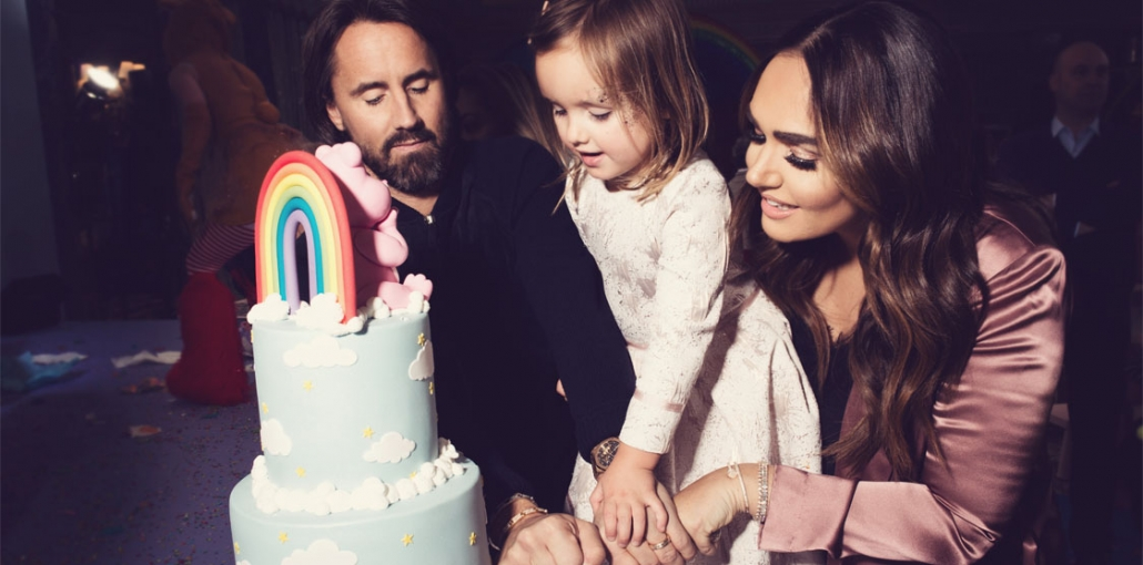 Tamara Ecclestone Rutland with her husband and daughter and birthday cake